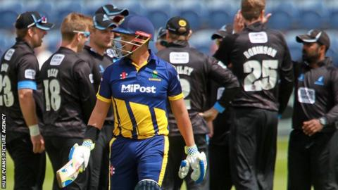 Glamorgan captain Jacques Rudolph walks off after being dismissed by Oliver Robinson for 1