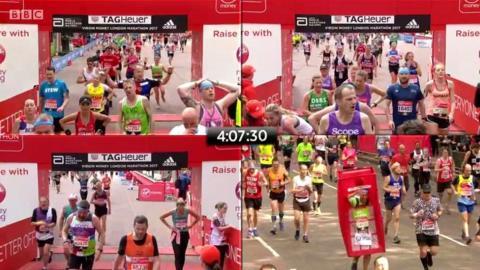Runners crossing the London Marathon finish line