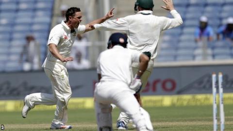Steve O'Keefe celebrates bowling India captain Virat Kohli