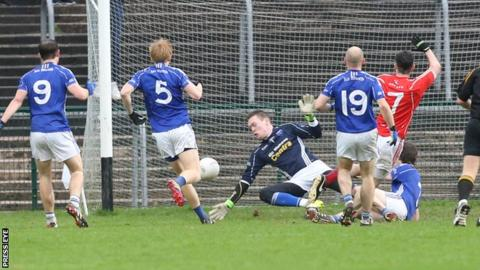 Trillick's Daniel NcDonnell scores the opening goal at Brewster Park