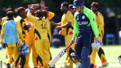 Papua New Guinea celebrate taking the wicket of Gary Wilson