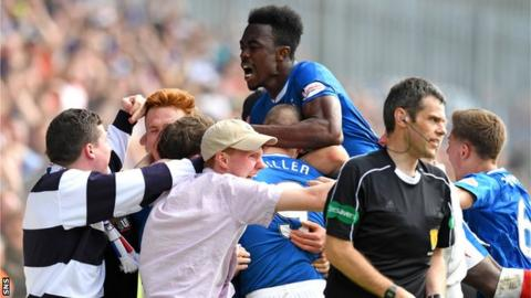 Rangers fans spill onto the pitch to celebrate with players after their injury-time winner against Partick