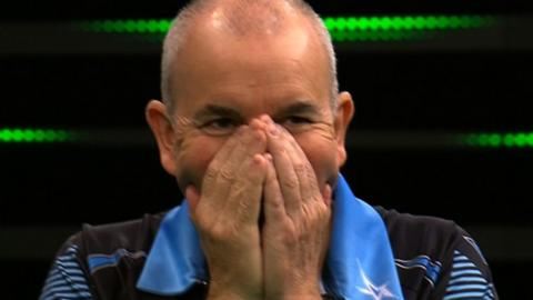 Phil Taylor throws eight perfect darts