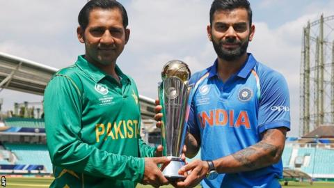 Sarfraz Ahmed and Virat Kohli with the Champions Trophy