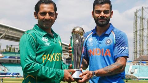 Sarfraz Ahmed and Virat Kohli with the Champions Trophy