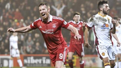Hat-trick hero Adam Rooney celebrates after netting his first of the night for Aberdeen