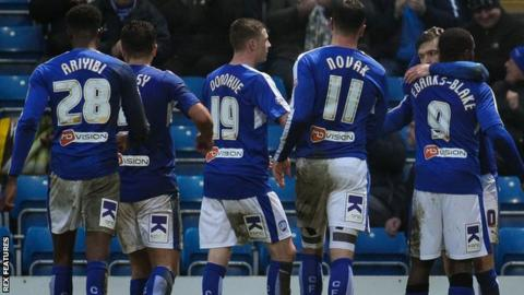 Chesterfield players celebrate another goal against Shrewsbury