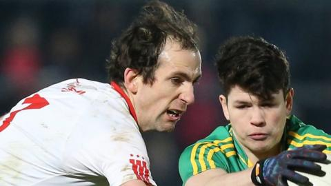 Tyrone's Justin McMahon battles with Donegal youngster Colm Kelly in the McKenna Cup game at Omagh on Wednesday night