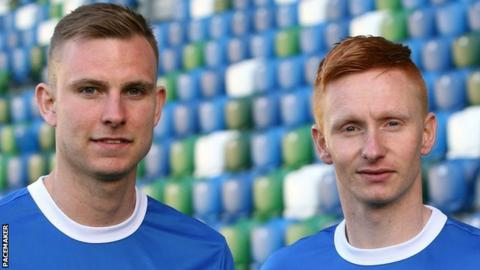 Andrew Mitchell and Robert Garrett have signed for champions Linfield