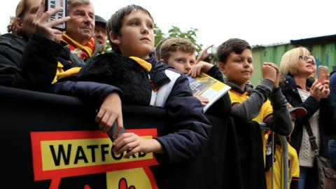 Watford fans await the players