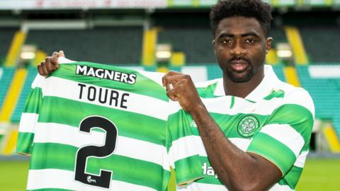 Kolo Toure shows off his new Celtic jersey