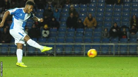 Ellis Harrison scores a penalty for Bristol Rovers to win at Oxford United