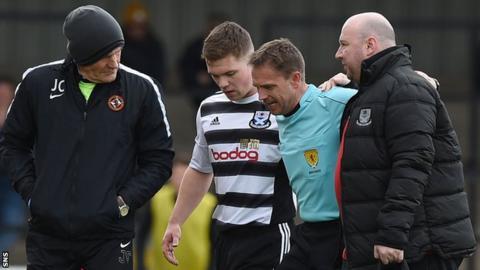 Referee Crawford Allan is taken off injured
