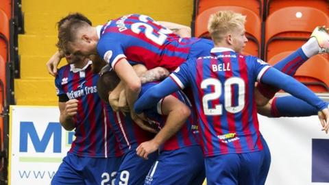 Iain Vigurs celebrates after making it 1-0 Inverness