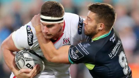 Ulster back row Robbie Diack is tackled by Osprey's Rhys Webb