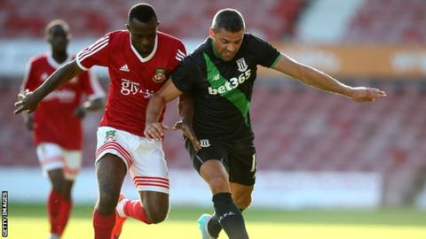 Stoke City's Jon Walters battles with Javan Vidal of Wrexham