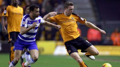 Wolves midfielder Kevin McDonald is challenged by Reading's Welsh international Hal Robson-Kanu
