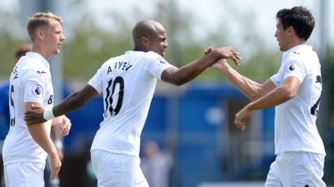 Andre Ayew celebrates with Stephen Kingsley and Jack Cork