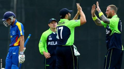 Stuart Thompson celebrates with Ireland team-mate John Mooney after the fall of a Namibian wicket