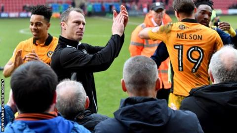 Mike Flynn applauds Newport County fans following the win at Crewe