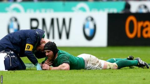Sean O'Brien receives medical attention following his injury at the Stade de France