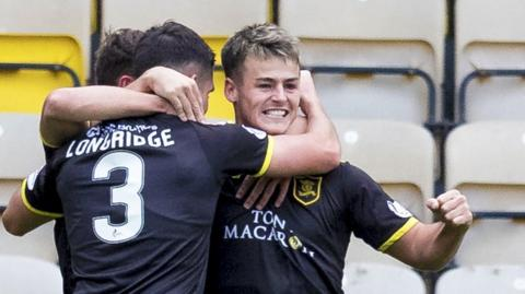 Livingston's Danny Mullen celebrates after making it 1-0