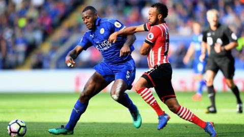 Leicester's Wes Morgan and Southampton's Nathan Redmond challenge for the ball