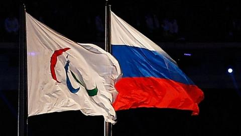 Paralympic and Russian flags