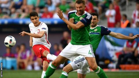 Bartosz Kapustka (left) in action for Poland against Northern Ireland at Euro 2016