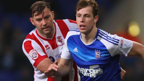 Ipswich's Adam Webster and Lincoln's Matt Rhead