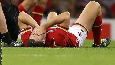 Cory Allen lies down injured