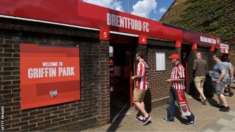 Fans enter Brentford's Griffin Park stadium