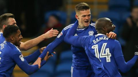 Cardiff City celebrate their late winner against Burton