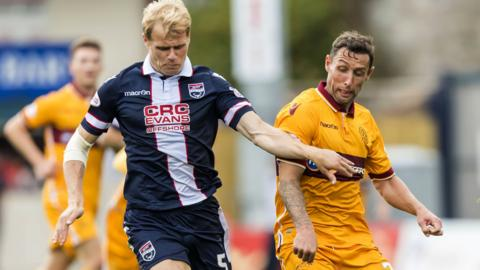 Motherwell's Scott McDonald (right) in action against Jay McEveley
