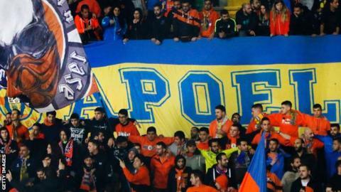 Apollon Limassol fans fly their flag