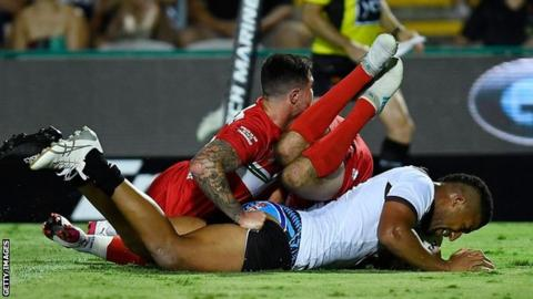 Viliame Kikau scores the first of his tries against Wales