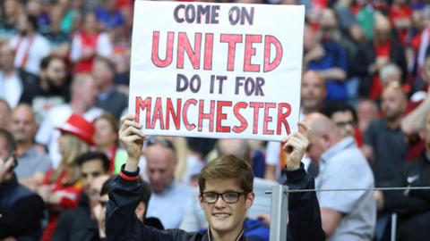 Manchester United fan with sign at Europa League final