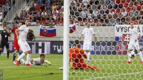 Adam Lallana broke Slovakia's resistance five minutes into added time