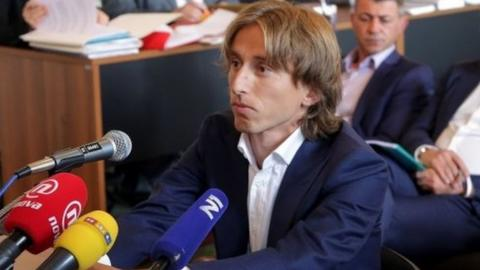 Croatia and Real Madrid midfielder Luka Modric appears in court to testify in a corruption trial in Osijek on June 13, 2017.