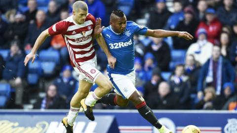 Alex Gogic and Alfredo Morelos