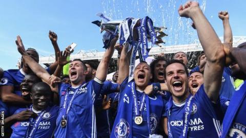 Chelsea celebrate winning the Premier League trophy
