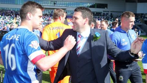 Matthew Clarke celebrates with Linfield manager David Healy after the club's 3-0 Irish Cup final win over Coleraine
