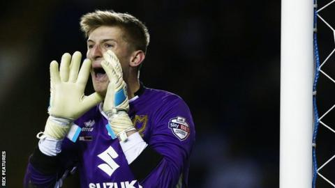 MK Dons extend keeper Burns' contract