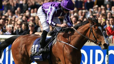 Minding triumphs in the 1000 Guineas at Newmarket