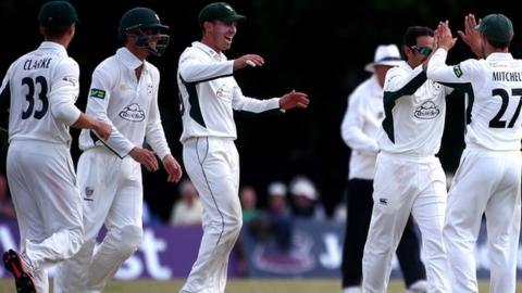 Saeed Ajmal is congratulated by his Worcestershire team-mates