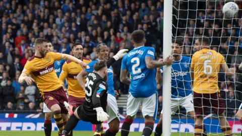 Louis Moult (left) opens the scoring for Motherwell