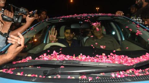 Babar Azam waves to fans from his car