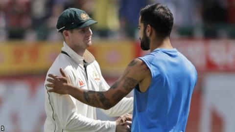 Australia captain Steve Smith (left) and India counterpart Virat Kohli shake hands after the fourth Test