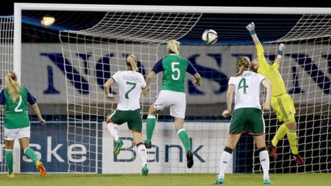 NI keeper Lauren Perry tries to save Megan Campbell's shot
