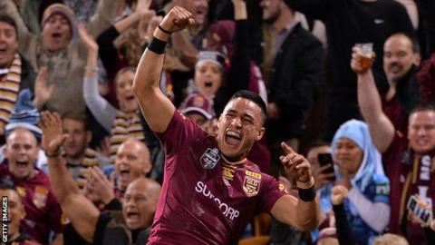 Valentine Holmes punches the air for Queensland after completing his hat-trick
